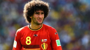 Marouane-Fellaini-of-Belgium-looks-on